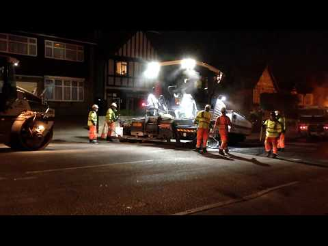 Late night heavy machinery in the street. Road resurfacing Loughton, UK