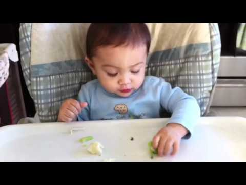 Baby eating his vegetables