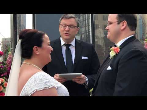 Rev.  Brad officiating a Rooftop wedding for Wedding Packages NYC