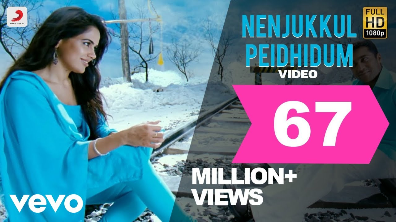 Download Vaaranam Aayiram - Nenjukkul Peidhidum Video | Harris Jayaraj | Suriya MP3 Gratis