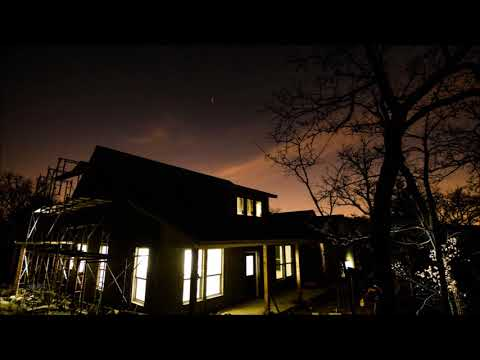day to night time-lapse new house with scaffolding