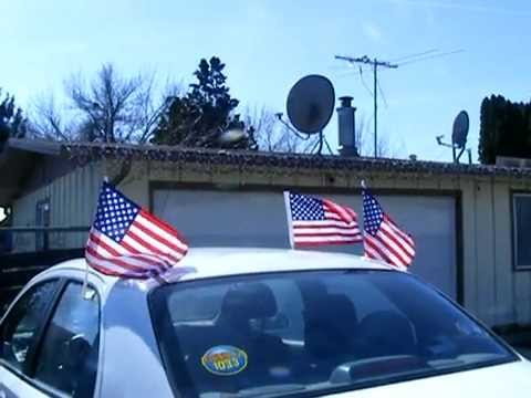 my patriotic car covered in dollar store flags from china, car made in korea. me made in usa