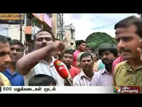 Residents  protest to shut down liquor shops near temples and schools. Women set to difficulty