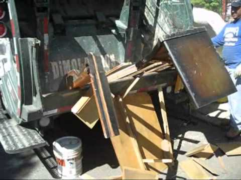 Crushing a Dresser during a furniture removal job in Glendale Queens, NYC