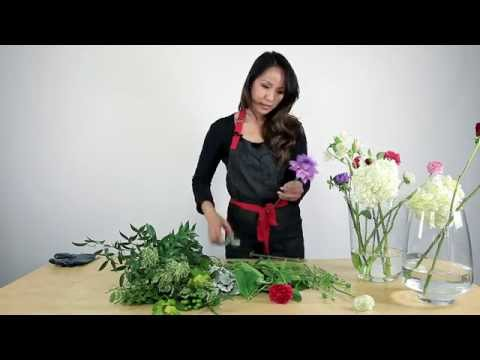 Preparing flowers for arrangement