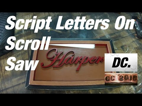 DC. script letters cut on scroll saw