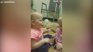 Mom catches her twin baby girls hugging each other