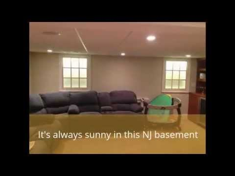 Bright Basement with Faux Windows by Monk's Home Improvements in NJ