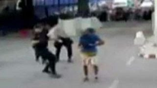Cop takes out knife-wielding man with traffic barrier