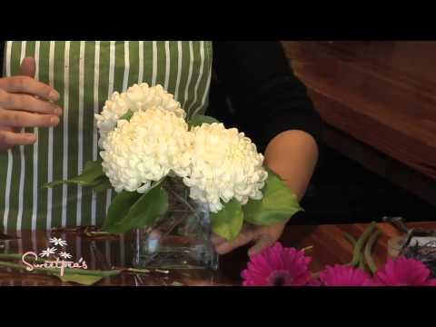 How to arrange flowers in a low vase