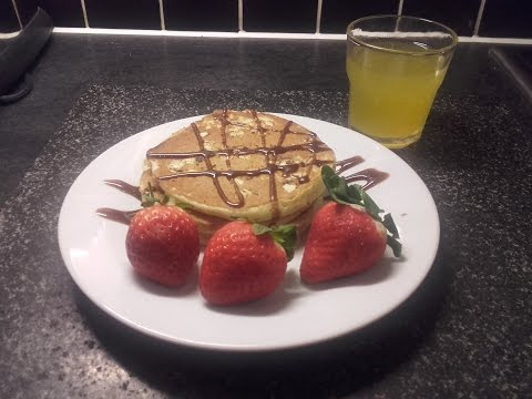 Delicious White Chocolate Pancakes with chocolate sauce and strawberries