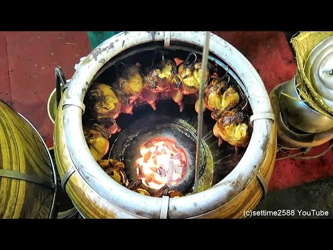 Bangkok Street Food. Roasted Chicken in Charcoal Oven. Thailand