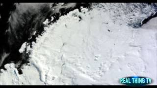 Mass Iceberg Breaks off completely and falls off into the sea