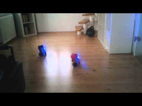 Two tin can based R2D2 like robots driving around
