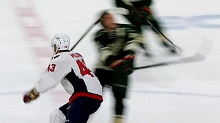 Parise helped off after taking fluke high stick at centre ice