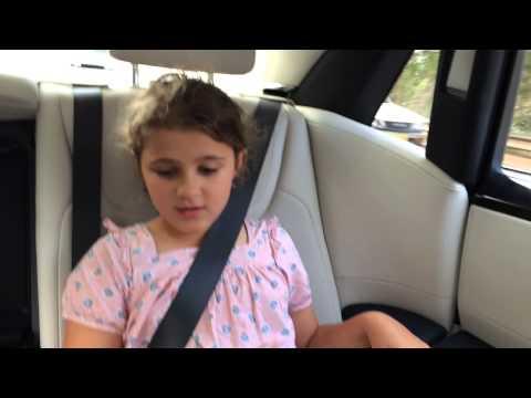 Children review a $750,000 Rolls-Royce