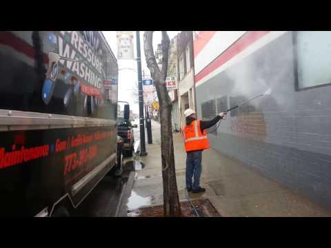 pressure washing graffiti off of auto zone store in chicago