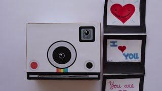 http://manualidades.facilisimo.com Si te gusta el estilo retro o vintage, no te pierdas los pasos para elaborar una original tarjeta para San Valentín en forma de la clásica cámara Polaroid.   Autora: Adriana, del canal Los versos y reversos: https://www.youtube.com/channel/UCGcR0Dnwbf8GczoqOtx8vuw  Plantilla: http://manualidades.facilisimo.com/como-hacer-una-original-tarjeta-para-san-valentin_1935210.html