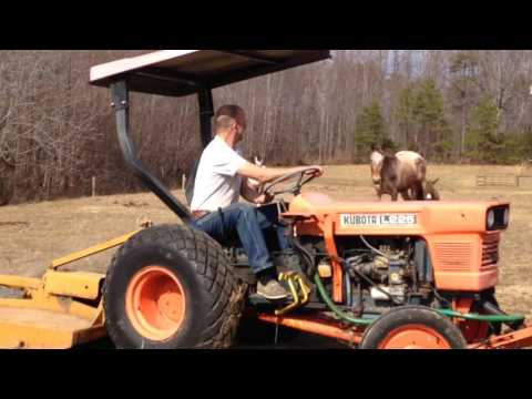 DIY Manure Spreader made out of recycled reused parts.