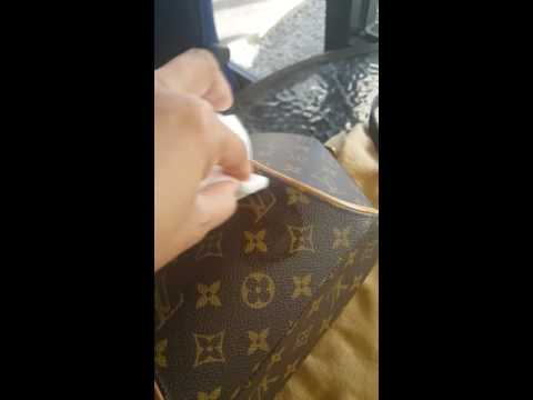 Cleaning white spot on Louis Vuitton monogram handbag. Magic eraser and water is the secret key.