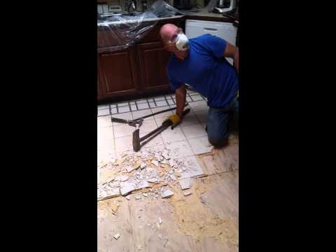 how to remove stubborn stuck on ceramic tile glued to particle board