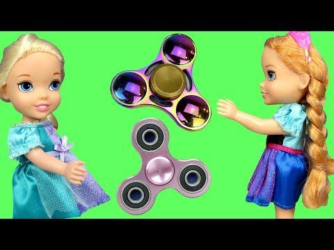Fidget Spinners !  Elsa & Anna Toddlers in Spinner Land - Toy Dinosaur