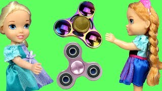 Fidget Spinners !  Elsa & Anna Toddlers in Spinner Land - Dinosaur breaks Spinner - Search - Playing