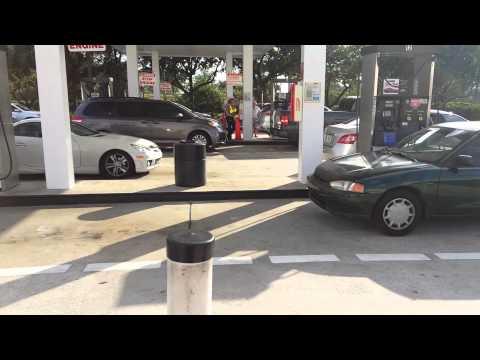 Malaka reversing into Costco's gas station