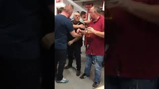 Nottingham Forest fans fight over the last pie at half-time