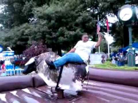 Son Riding Fake Bull