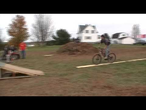 bicycle jumping on homemade ramp.