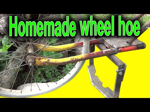 Homemade wheel hand hoe. Garden wheel hoe