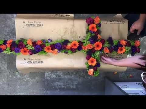 Vibrant Cross Funeral Flowers Tribute