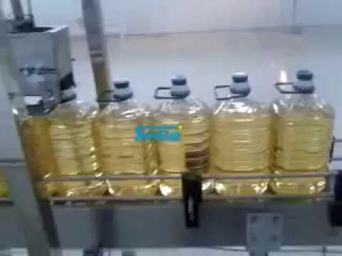 Automatic linear type edible cooking oil filling machine in bottle barrel or jar or can