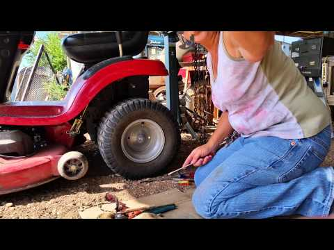 How Did I take a tire off a lawn tractor?