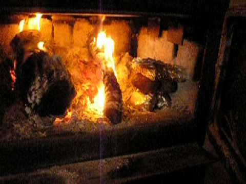 cooking inside a woodstove / baking potatoes = hot dogs =