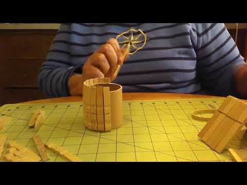 Making well houses out of clothespins.