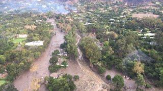 Mud and boulders slide down California hills - aerial video