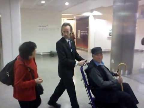 LONDON HEATHROW AIRPORT TERM 3 wheelchair tout UGLY FRANKENSTEIN MAN