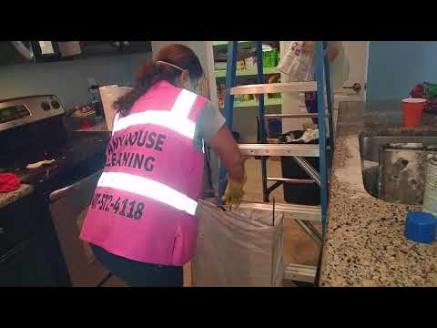Using Easy Off to clean oven racks, inside oven. Deep House Cleaning