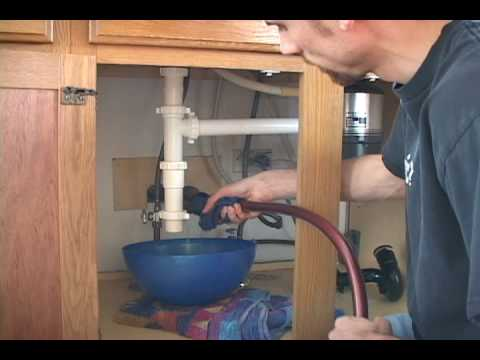 How to Unclog a Sink Without Toxic Chemicals - Using A Hose