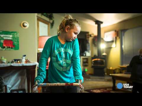 A young girl fights to walk again following enterovirus