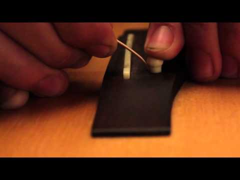 How to restring an acoustic guitar with D'Addario strings.