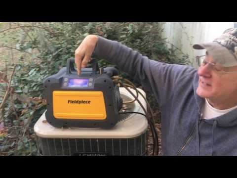 Fieldpiece MR45 recovery unit recovering refrigerant from an air conditioner.