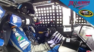 Junior drives one-handed without steering wheel