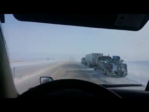 HOW TO drive a Semi Truck on snow and icy freeway safely, using warning bumps and emergency blinkers