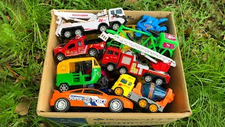 Lots of various medium sized toy vehicles from the Box and Introducing with them