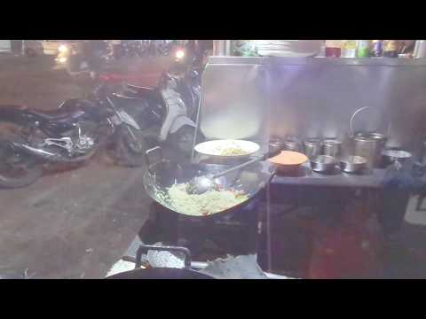 People enjoying tasty fried rice Chinese street food