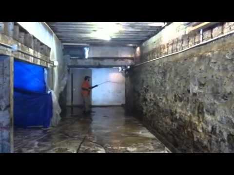 Pressure washing concrete basement