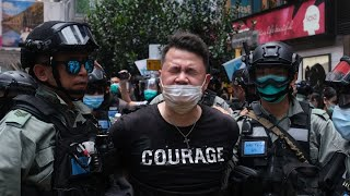 Hong Kong Police Make Arrests as Protesters Defy Ban
